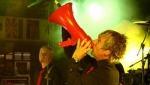 Martin paints the megaphone red