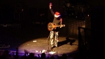 Stu G performs 'Silent Night' in his Christmas hat